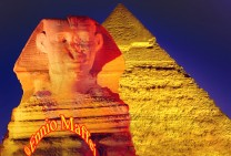 Giza Sphinx And Cheops Illuminated