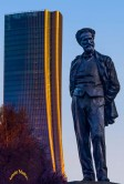 Statue Of Composer Giuseppe Verdi With Generali Tower in Backgroung